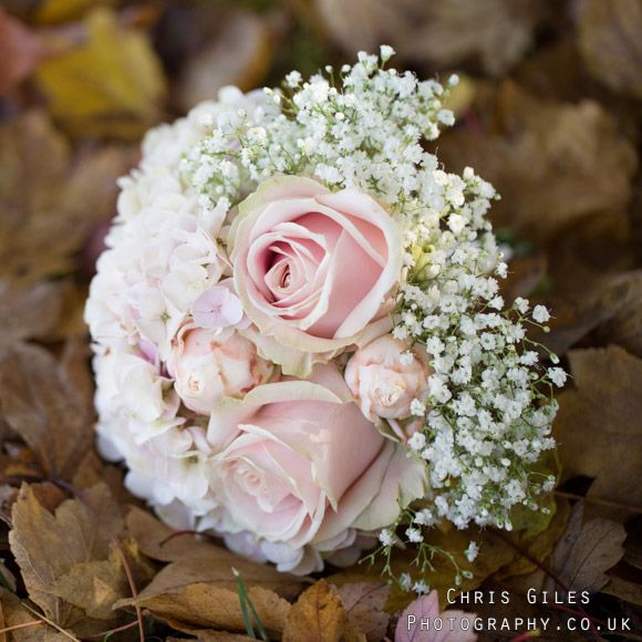 This cute posy features pretty gypsophila, blush pink roses and hydrangea. Gorgeous #bridalbouquet design by www.blush-floral-design.com