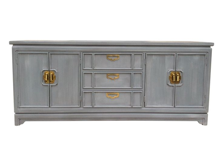 Family Room Gorgeous!  Solid wood, very heavy vintage Thomasville sideboard buffet. This piece has been hand painted in shades of umbers, greys and rococo clay to give of subtle, elegant finish with beautiful depth and texture. Three center drawers and each end cabinet has a shelf for plenty of storage. This would be perfect in the dining room, as a media center or credenza in the living room or office and can be used as a dresser in the bedroom.