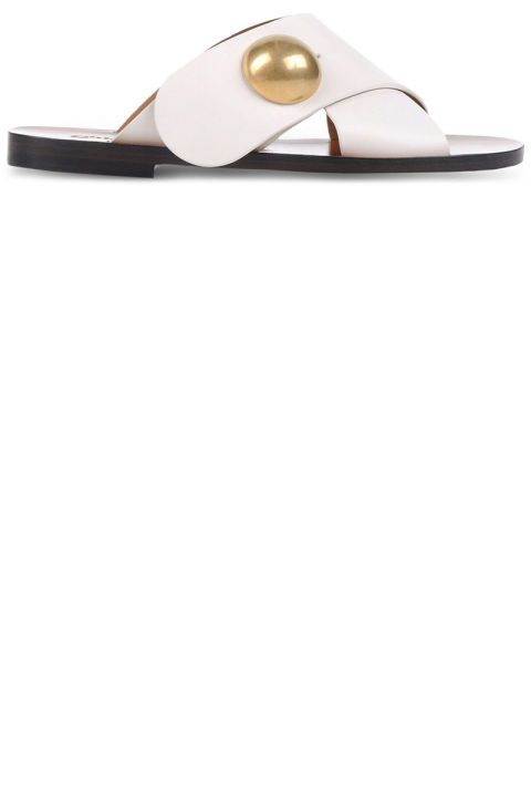 14 summer sandals to go with summer outfits: Chloe slip on white sandals with gold embellishment.