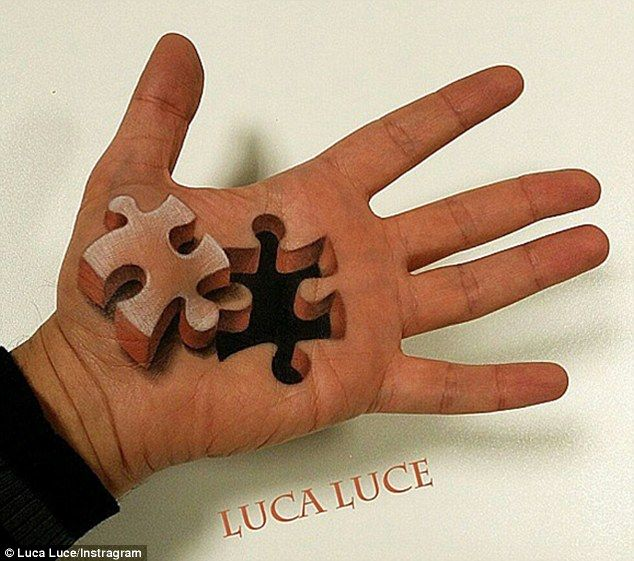 Luca Luce creates artwork on his palm to give the illusion of a jigsaw piece missing from his hand