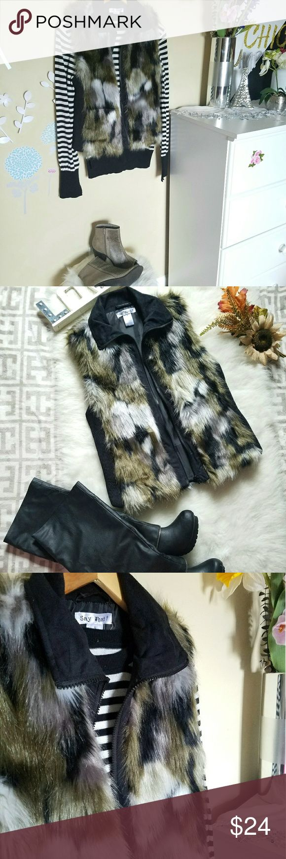 🍁🖤NWOT Faux Fur Vest🖤🍁 Faux fur material on back and front.  Zips in front.  Pockets on both sides.  Has some stretch due to black material on sides.  A size M, runs a bit S, so can work for XS-M (Juniors). Jackets & Coats Vests