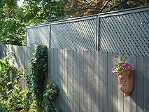 How to Heighten a Privacy Fence - Fence with extension made from lattice panels.