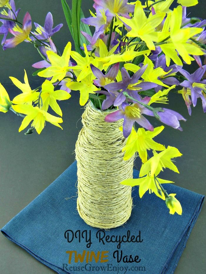 Need to add a little country style to your home? If you like to make crafts from recycled items, check out this easy DIY Upcycled Twine Vase! http://reusegrowenjoy.com/diy-upcycled-twine-vase/