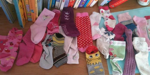 Desk full of socks with missing pairs. I really do think there is a sock thief!