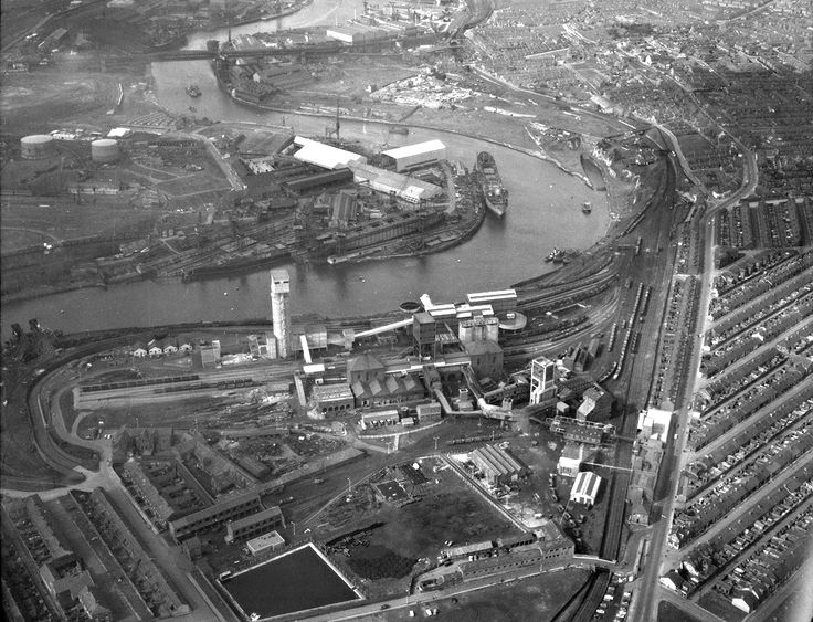 Aerial view of Wearmouth Colliery, Sunderland, June 1962 (TWAM ref. DT.TUR/2/29271B). This image also shows the Deptford Shipyard of Sir James Laing & Sons on the opposite side of the River. This set of aerial images is intended as a short historical tour of the River Wear from the Piers to Pallion. It gives us an impression of what the River looked like during the middle years of the Twentieth Century, when it was a hive of industrial activity. Sunderland had an internationa...
