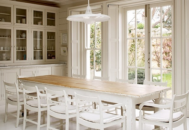 dining room with plank walls, built in glass front cabinet, french doors to patio, lots of light