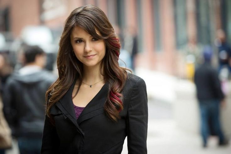 i love elena's new hairstyle! lovin' the extra touch of red streak.
