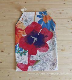 Nelle settimane scorse, per mia figlia, ho cucito un abito prendisole molto semplice. Si tratta di un vestitino fatto con pochissime cuciture che si può tranquillamente realizzare in mezz'ora di tempo, basta avere a disposizione un altro abito per copiarne le misure e realizzare così il proprio cartamodello personale. Questo progetto è l'ultimo dei coordinati...