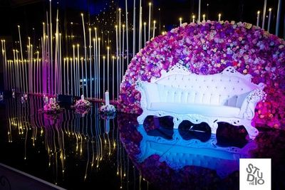 stage backdrop, outdoor stage backdrop,  floral wall, white sofa seating,  orchids, purple and white,                                                                                                                                                                                 More