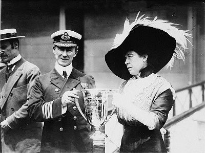 Capt. Arthur H. Rostron, master of Carpathia, rescuer of Titanic survivors, accepts Loving Cup from Margaret Brown