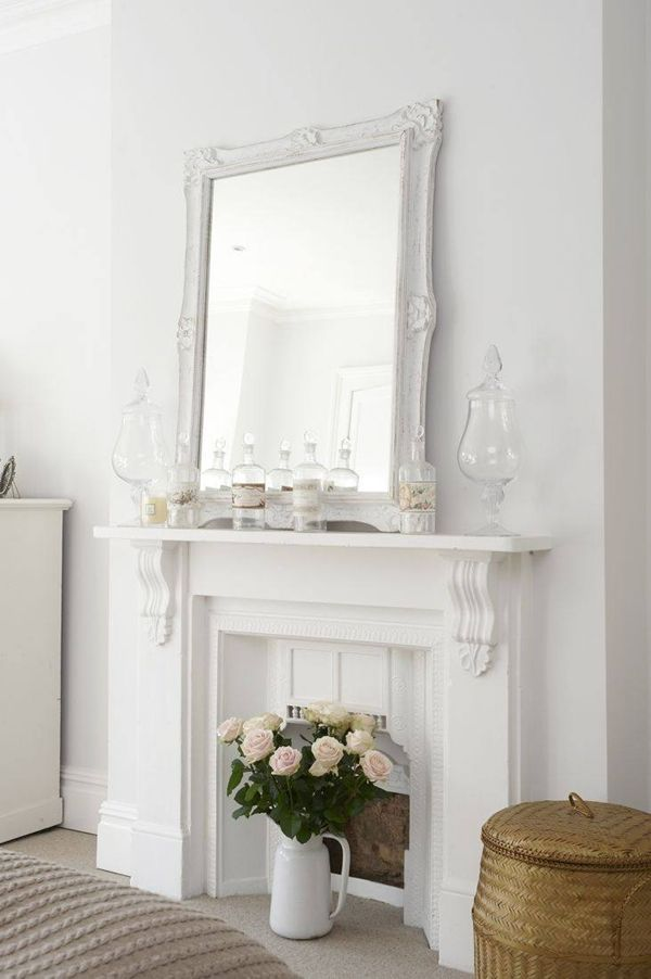 I want a fireplace.. instead of the bottles and apothecary jars... I think I would have done candles :D Love the flower arrangement