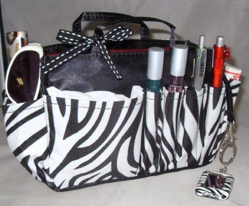 "Jolie Zebra Print and Black Handbag Organizer Insert Travel Cosmetic Make-Up Bag Tote Dimensions: L 7.5""x H 6""x W 3.5"" by BagManager. Save 68 Off!. $9.66. Changing bags is fast and easy with built in handles!. Turns ugly mess into organized success.. 10 handy pockets/compartments to hold/protect all essentials.  Never lose your keys with built in key hook.. Ideal for smaller bags and makes a terrific gift.. Use For: Handbags, Tote Bags, Travel Bags, Car Consoles, and More!. This stylish..."