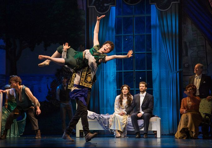 "Melanie Moore as Peter Pan in ""Finding Neverland"" at the Lunt-Fontanne Theater, with Laura Michelle Kelly, seated center left, and Matthew Morrison."