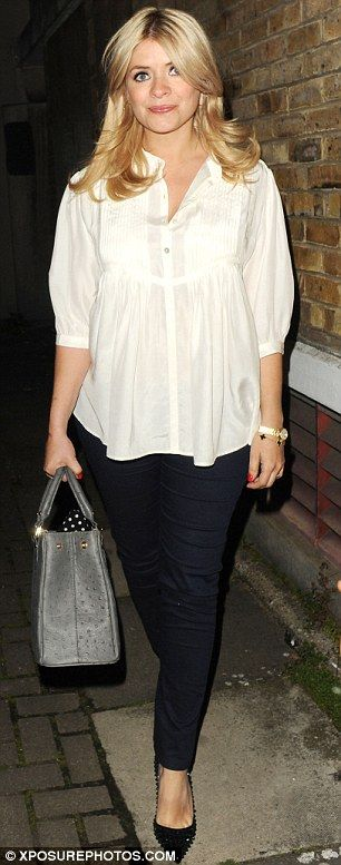 Cute and chic: The TV presenter opted for a white smock-style top, with buttoned detailing at the top