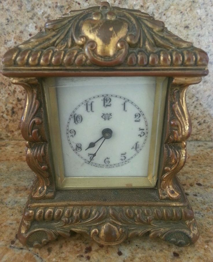 """SIMPLY STUNNING! VERY OLD AND SIGNED WITH 4 PATENTED DATES ON BACK: MAR. 19 1889 MAY 6 1890 DEC. 23 1890 JAN. 13 1891 SIGNED ALSO WATERBURY CLOCK COMPANY USA ON BACK. HAS LOGO ON FACE AND SIGNED WATERBURY CLOCK USA ON FRONT FACE ALSO. WAS IN MY GRANDFATHERS COTTAGE SINCE I WAS A SMALL CHILD. A VERY COLLECTABLE ANTIQUE CLOCK IN EXCELLENT CONDITION. RUNNING AND CLEANED AT CLOCK SHOP! 4-1/2"""" tall 4"""" wide at bottom   eBay!"""