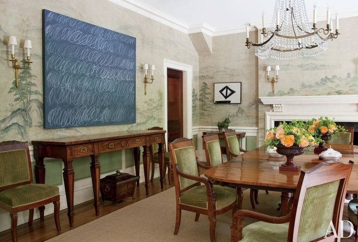 "A Cy Twombly ""Blackboard"" painting and a small geometric Franz Kline play off the hand-painted Gracie scenic wallpaper in the dining room of a Philadelphia-area house designed by Thomas Jayne; surrounding the late-Georgian dining table is a suite of Empire chairs.  ARCHITECT: n/a DESIGNER: Jayne Design Studio Inc. PHOTOGRAPHER: Roger Davies"