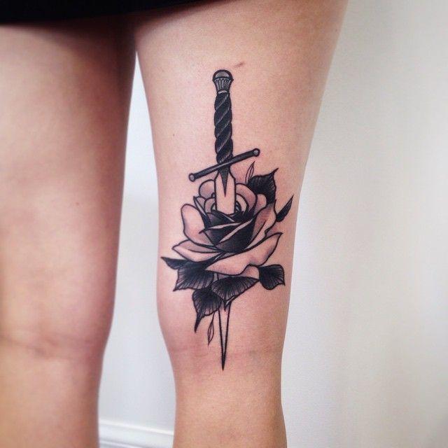 Rose And Dagger Tattoo By Pari Corbitt http://tattoos-ideas.net/rose-and-dagger-tattoo-by-pari-corbitt/