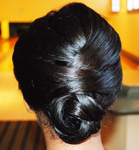 Believe it or not, this romantic low bun look is DIY-friendly. @UpDo's For I Do's LLC shows us how!    #diy #hairstyle #weddings #africanamerican #lowbun