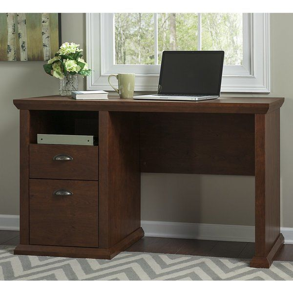 With the Darby Home Co® Watertown home office desk in antique cherry, you can build a work area in a unique and beautiful craftsman style. In an antique cherry finish with a distressed aesthetic, the office desk is both beautiful and functional. Large surface area provides space to work comfortably and spread out with a laptop, papers and more. The open cubby shelf below the surface stores a tablet or laptop when not in use. A box drawer holds office supplies while a full-extension file…