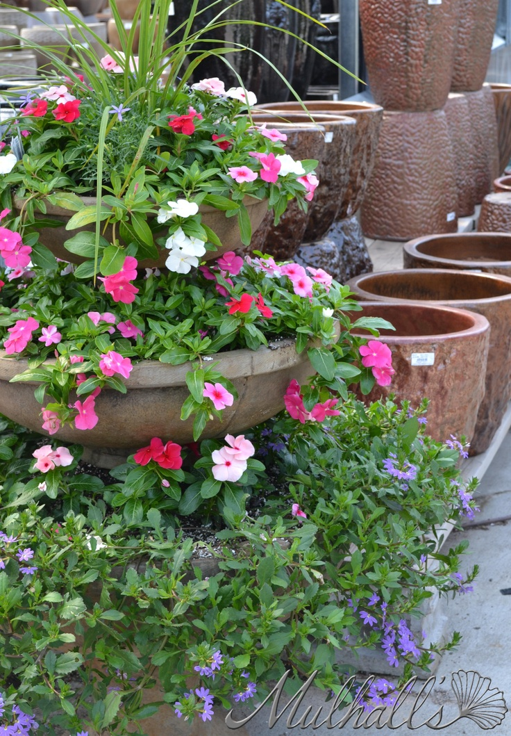 Three tier planter spilling over with color for next to for Tiered garden designs