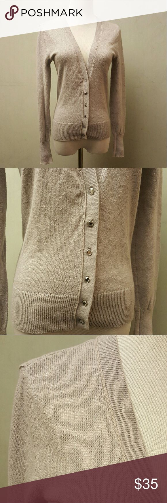 Banana Republic silver cardigan Banana Republic silver cardigan with Crystal buttons in good condition has a shiny Silver Thread going through the knitting Banana Republic Sweaters Cardigans