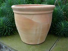 Nice garden pots. Tuscan style?
