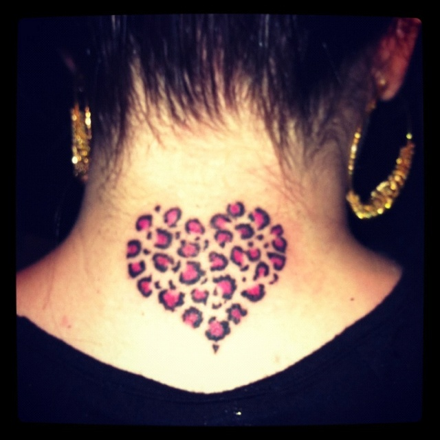 Heart outline filled with half cheeta and half tiger