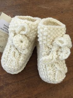 Cutest little Baby Bootees handmade in Ireland using finest pure wool and traditional Aran Fisherman patterns. Great gift for a new arrival!