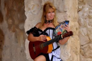 """Galina Vale""""She is stunningly beautiful, with a vibrant stage presence and she is a simply brilliant guitarist – check her out on YouTube playing the Paganinni Caprice No.24 blindfold!"""