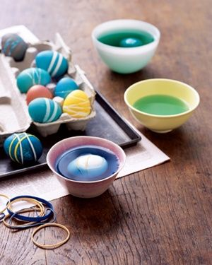 Decorate eggs by positioning bands around them in a pattern before dipping them into the dye.