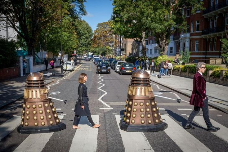 Peter Capaldi, Jenna Coleman and friends recreate an iconic image on Abbey Road.