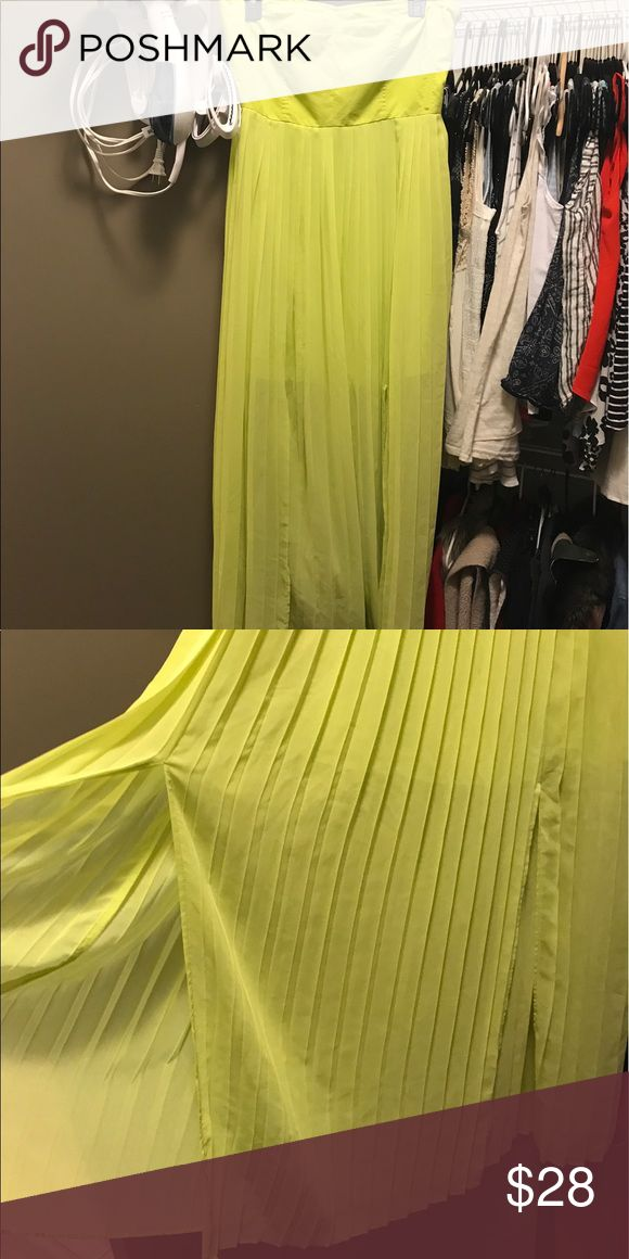 Neon yellow slit maxi dress I love neons for the summer and this one takes the cake! Pair with some wedges or some gladiator sandals for the perfect outfit! Transition it to night time with a slick jacket for a versatile piece! Dresses Maxi