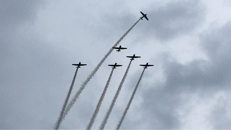Missing Man formation in honor of Blue Angel Captian Kuss flown by the GEICO Skytypers today at the airshow in Smyrna.