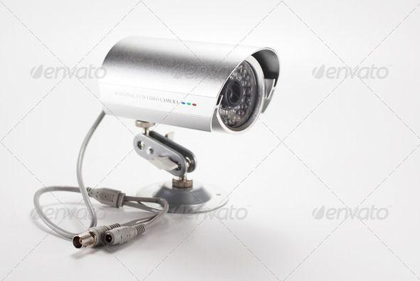 Silver surveillance camera. http://photodune.net/item/silver-isolated-video-surveillance-camera/1534343