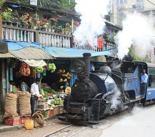 "Brilliant - just as I remember it - riding right next to shops and people's living rooms.  Darjeeling Himalayan Railway - the ""Toy Train"" rolls through India."