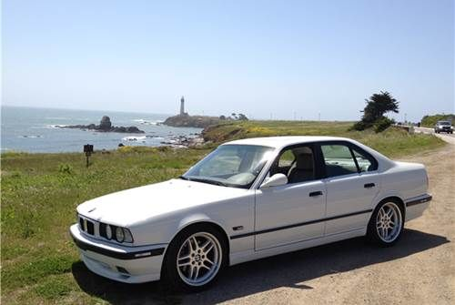 1995 BMW 540 M-Sport  goodnight gorgeous   your in storage in los angeles   muahh kisses!  goodnight put the car cover on   laughing red!