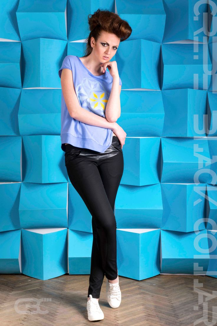 Asymmetric blue Tshirt with blue, grey and yellow geometric flowers. Black pants with black concentric petals. Order via facebook, pm or e-mail.