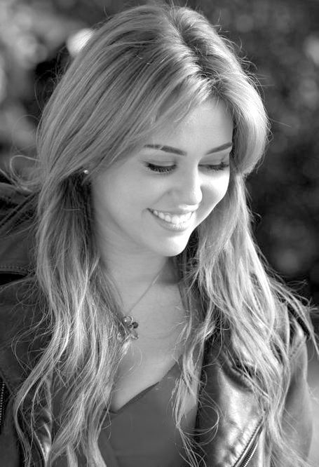 Miley Cyrus; A lot of people hate her, but I don't. Why? She's a person just like anyone else. She goes through life just like we do.