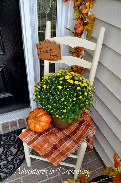 easy decorating ideas for fall and halloween for the front porch with pumpkins and flowers