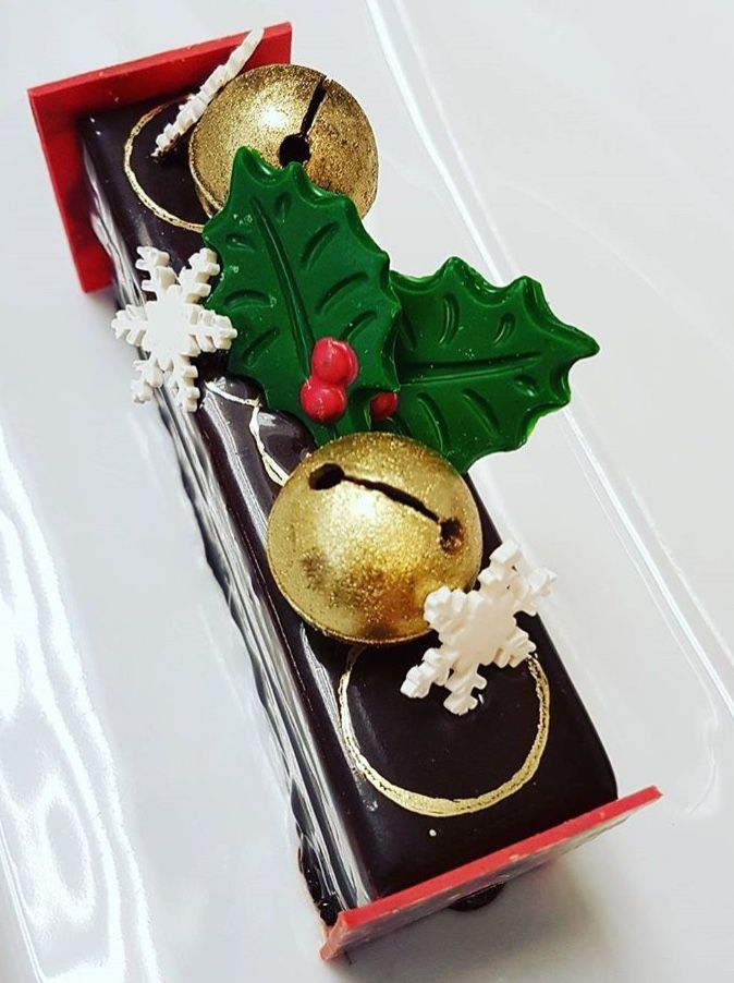 Bûche de Noël - one of the beautifully delicious desserts that Pastry Chef Ely Rowan & the team @HotelArtsYYC have been preparing for holiday season parties. #yycevents #yycfood #desserts #chocolate #christmasdesserts