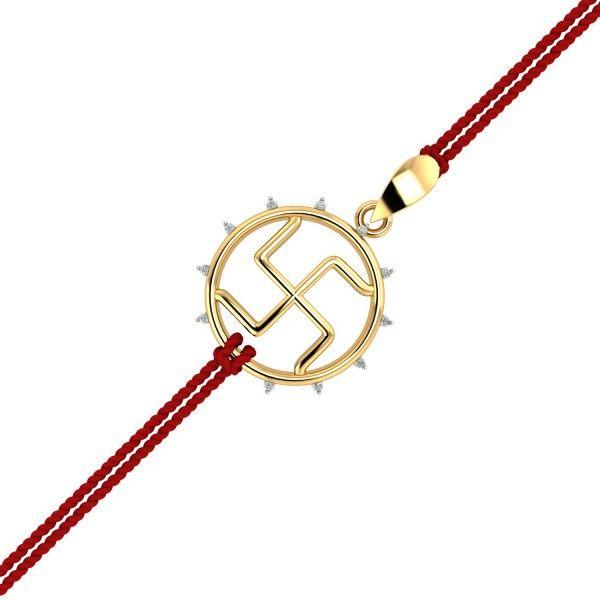 SWASTIK GOLD RAKHI PENDANT.The symbolic swastik shape with all its divinity capsuled in the form of a gold rakhi for your brother. It can be used as both, a rakhi and pendant. It has diamonds studded on the outer circumference. #Rakhi #GoldRakhi #GoldandDiamond #RakhiCumPendant #RakhiGift #GiftforBrother #SpecialRakhiGift #RakshaBandhan #18thAugust #RakhiCelebration #BrotherSisterBond #Kuberbox #ShopRakhiOnline #OnlineJewellery