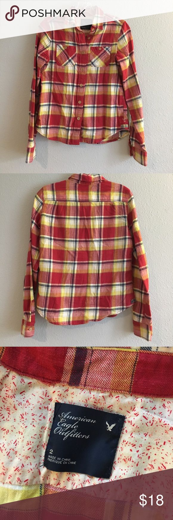 Red Plaid Flannel American Eagle Shirt Excellent used condition! The perfect plaid flannel shirt from American Eagle Outfitters. Red, yellow, white, and navy plaid. Two front chest pockets. Very cozy and comfy! American Eagle Outfitters Tops Button Down Shirts