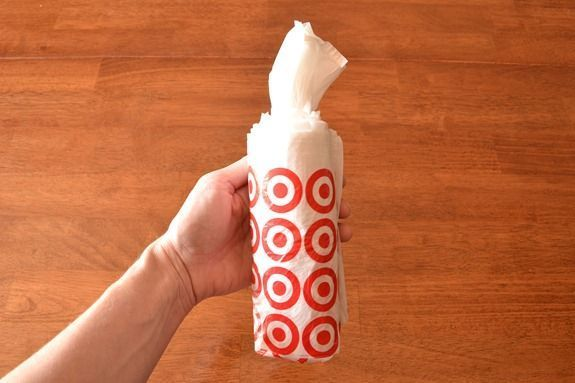 How to roll plastic bags so they come out like wipes. thanks pinterest! finally I can tame the cabinet of bags.
