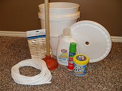 5-gallon bucket with lid (cut hole in middle of lid for plunger handle to fit through)  Toilet plunger (brand-new, clean)  Store in bucket:  Liquid laundry detergent  Stain remover/stain stick  Vinegar (add 1/2 cup to rinse water) helps remove soap  Rope (for clothes line)  Clothes pins
