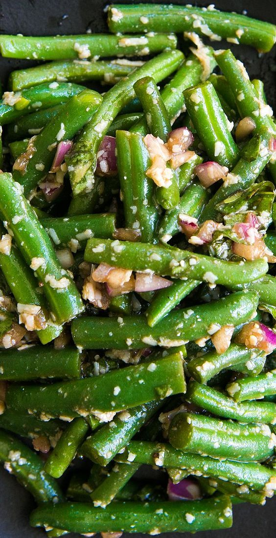 Fresh green beans, blanched and toss with a balsamic vinaigrette, red onions, basil, and Parmesan. On SimplyRecipes.com