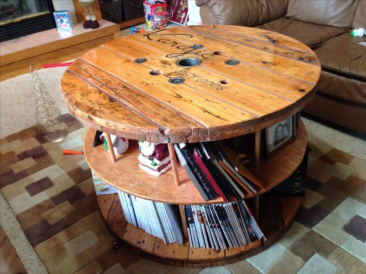 Repurposed cable spool made into coffee table/shelf by my hubby Rifet, I did the stencil on top