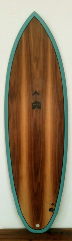 Wooden surfboard. Dope.
