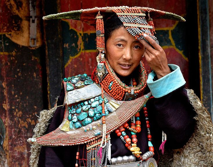 Pictures show women's costume from the Purang County in Ngari Prefecture, western Tibet (http://www.tibettravel.org/tibet-travel-guide/ngari-guide.html). The Purang women's costume, with a history of 1,000 years, has a distinctive and delicate style. Still popular today, the most attractive part of the costume is its representation of peacock -- an inspiration drawn from the local Peacock River, whose headwater flows like a peacock, which is the symbol of beauty and luck.