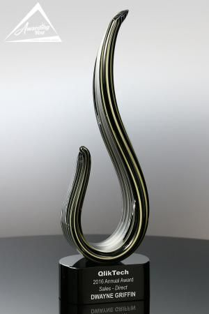 The Parlance Art Glass Award is a gorgeous blend of black and gold glass mounted on a black optic crystal base.  The award stands 13.25 inches tall.  Art glass awards are great options when you want to add really unique and colorful awards to your program.  The Award is very popular for Chairman's Awards, Sales Awards, Commemorative Awards, Staff and Employee Recognition and Management Awards.