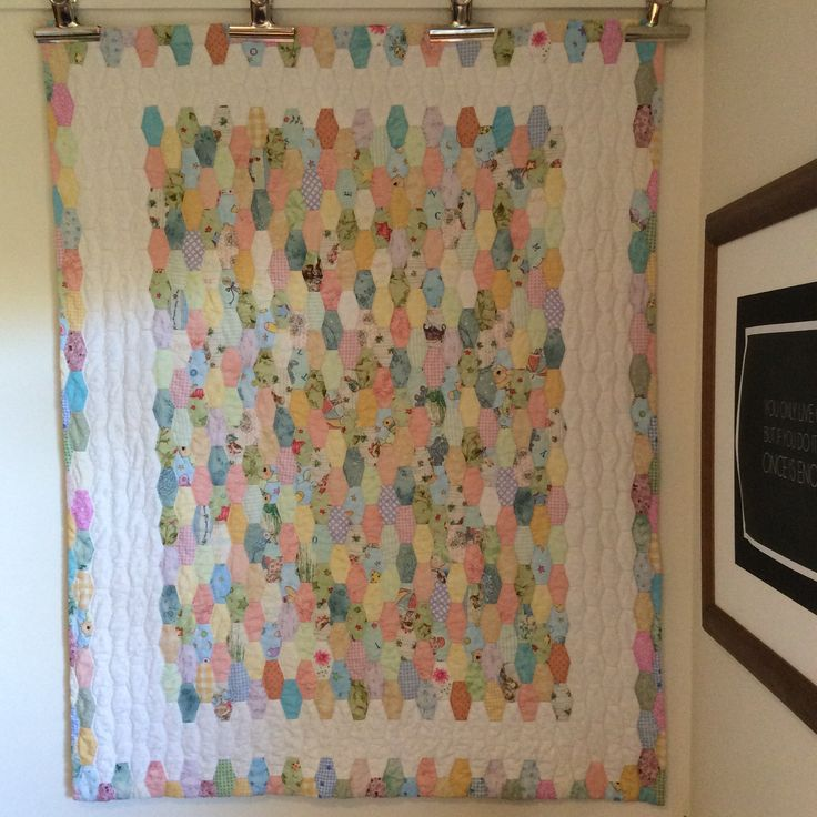 Paper pieced, totally hand sewn and quilted.